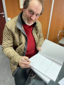 François Pernel signing his book, at the Camac offices